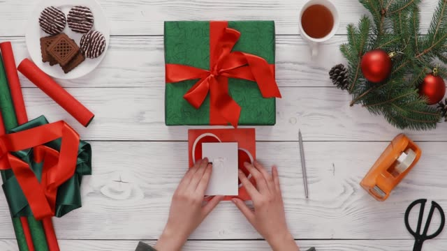 Writing A Christmas Card Top View She Writes A Christmas Card For A Loved One. Hands Only, High Angle View pine nut stock videos & royalty-free footage