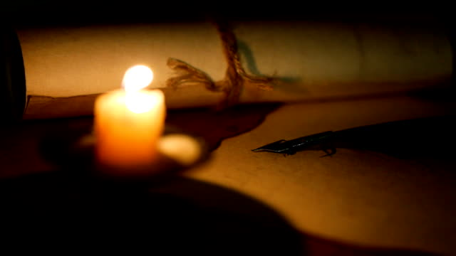 writing letter with quill pen in the light of candle video