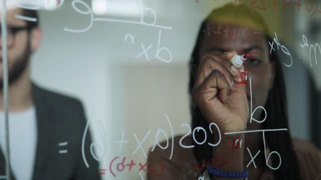 Writing Mathematical Formulas On Glass Board