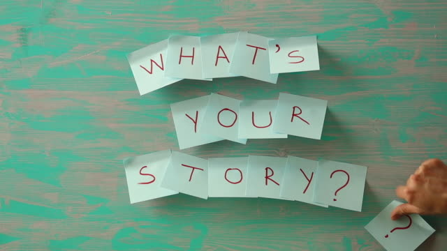 writing note showing what's your story question. - fiaba video stock e b–roll
