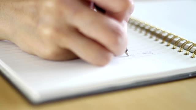 skrivande notebook - anteckningsblock bildbanksvideor och videomaterial från bakom kulisserna