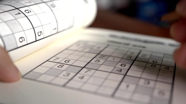 Writing on Sudoku puzzle with pencil