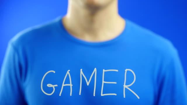 Writing the word.  GAMER.