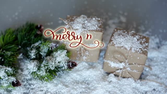 Written Merry merry Christmas vintage Calligraphy text on Christmas decor background with gifts. lettering flourish elements. Christmas holidays feeling video