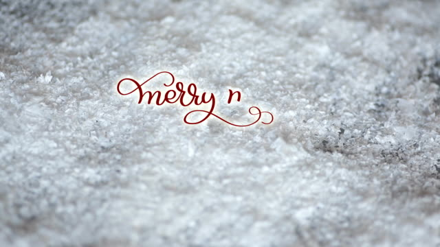 Written Merry merry Christmas vintage text on snow background. Calligraphy and lettering flourish elements. holiday feelings video