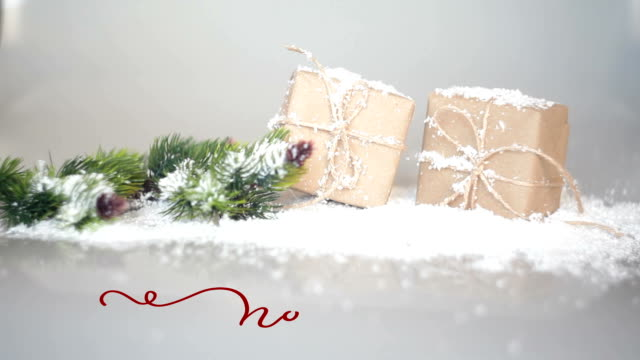 Written noel vintage word on Christmas decor background with gifts. Calligraphy and lettering flourish elements. Christmas holiday video