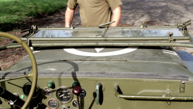 Wyllis, Old Jeep raise the windshield in old Jeep us military stock videos & royalty-free footage