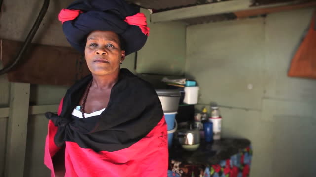 Xhosa woman portrait Video portrait of a Xhosa woman in her township home looking at camera and smiling western cape province stock videos & royalty-free footage