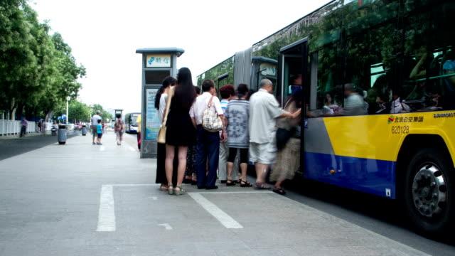 stockvideo's en b-roll-footage met xidan bus station at daytime hd. - bushalte