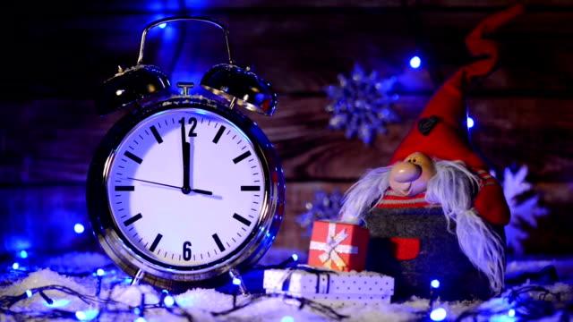 Xmas set with big alarm clock counting to twelve o'clock video