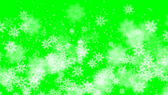 vídeos de stock e filmes b-roll de xmas winter green background snowfall snow merry christmas particles fly in slow motion in the air 4k - christmas card