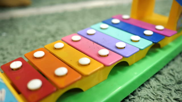 xylophone toy in rainbow color. education toy for kid and toddler - banchi scuola video stock e b–roll