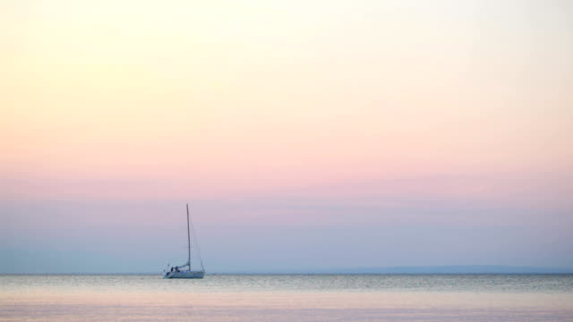 Yacht at sunset video