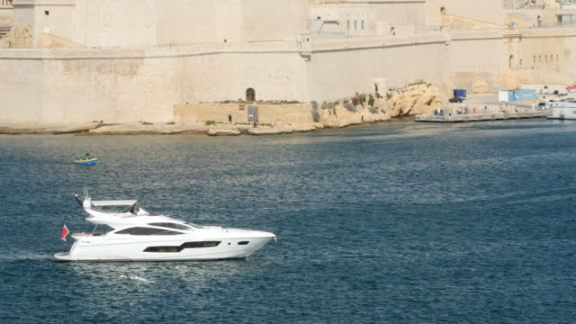 Yacht in the port of Valletta in the island of Malta video
