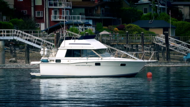 Yacht Moored In The Bay Typical white yacht near buildings in the sun military private stock videos & royalty-free footage