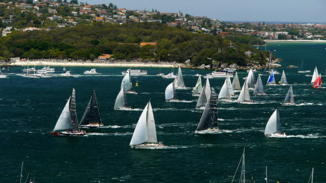 yacht race yachts leave sydney at the start of a famous yacht race regatta stock videos & royalty-free footage