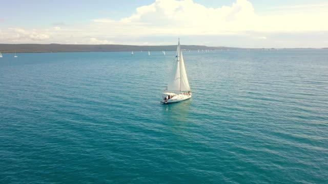 Yacht sailing on opened sea. Sailing boat. Yacht from drone. Yachting video. Yacht from above. Sailboat from drone. Sailing video. Yachting at windy day. Yacht. Sailboat Yacht sailing on opened sea. Sailing boat. Yacht from drone. Yachting video. Yacht from above. Sailboat from drone. Sailing video. Yachting at windy day. Yacht. Sailboat. mast sailing stock videos & royalty-free footage