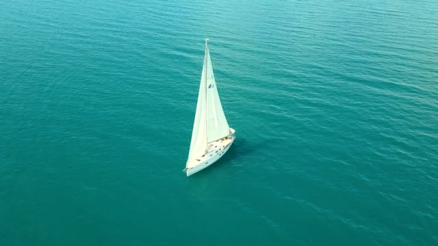 Yacht sailing on opened sea. Sailing boat. Yacht from drone. Yachting video. Yacht from above. Sailboat from drone. Sailing video. Yachting at windy day. Yacht. Sailboat video