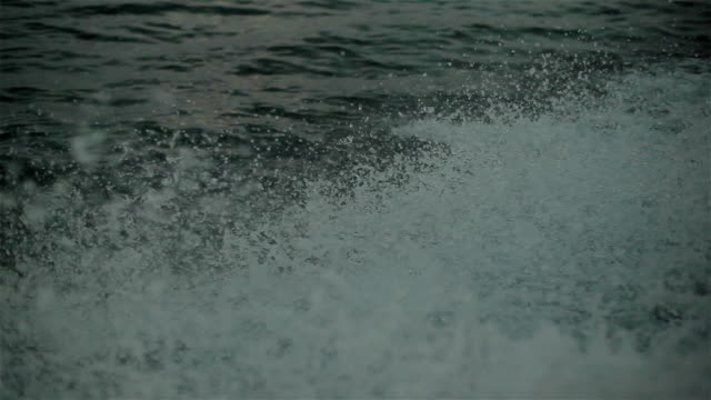 Yachting at lake sunset time. Splashing waves. 5 shots in a sequence video