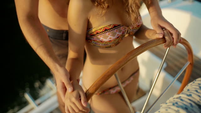 Yachting. Guy teaches the girl of yachting. video