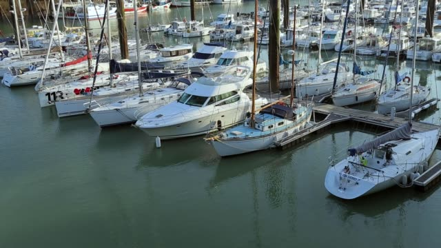 Yachts and sailboats moored in a harbor of Dieppe, France. Vacation, luxury lifestyle and wealth concept video