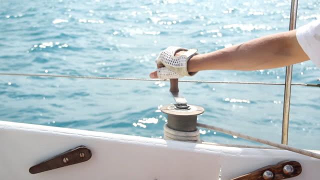 Yachtsman sails controls  mast sailing stock videos & royalty-free footage