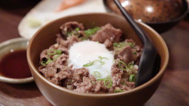Yakiniku don, Japanese Rice Bowl with Egg Yolk and Gyudon Wagyu Beef.