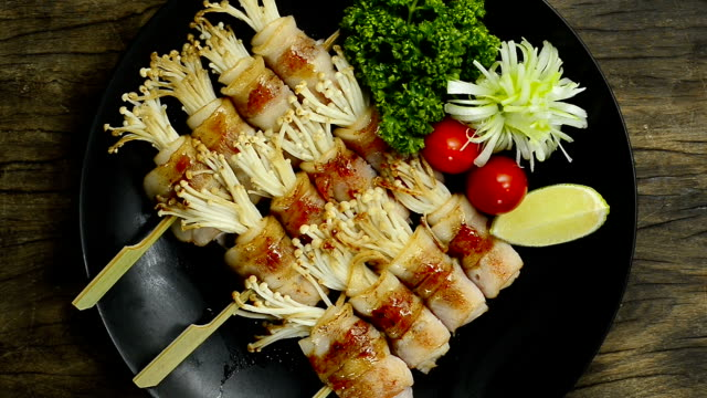 Yakitori Grilled Bacon and Golden Needle Mushroom Wrapped Skewers Japanese Food