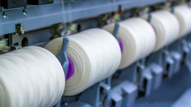 Yarn spools on spinning machine in a factory video