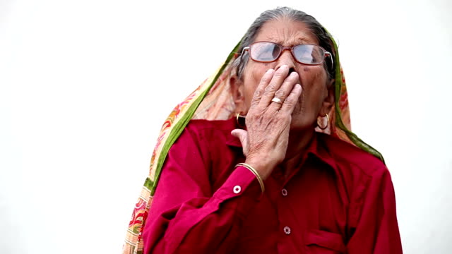 Yawning old woman Full HD : Traditionally Indian older woman yawning over white background. haryana stock videos & royalty-free footage