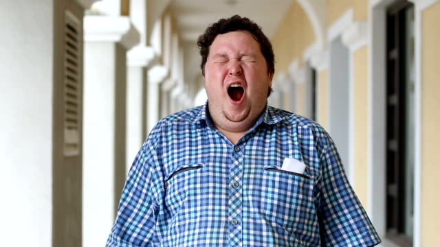 Yawning Tired Fat Man , Napping , Outdoor Yawning Tired Fat Man , Napping , Outdoor. Face of a fat man wearing plaid shirt outdoor. yawning stock videos & royalty-free footage