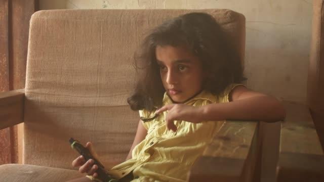 5 year old girl watching tv