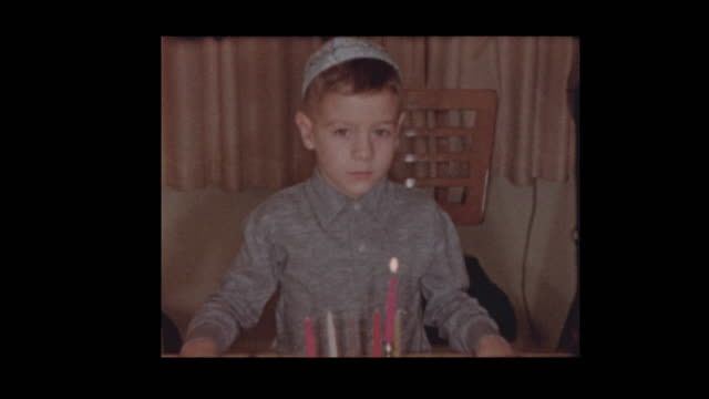 1958 6 year old Jewish boy lights Hanukkah candles 1958 6 year old Jewish boy lights Hanukkah candles hanukkah stock videos & royalty-free footage