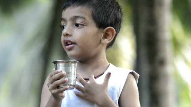 4 years boy drinking water one boy, aged 8, outdoors, drinking water, tap thirsty stock videos & royalty-free footage
