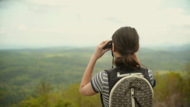 14 years old teenager girl observing Cherokee National Forest in Great Smoky Mountains, Appalachian, from Cherahola Skyway, Tennessee, USA. video