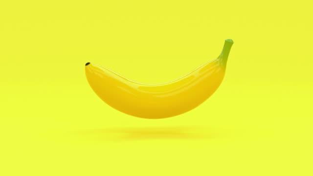 黄色の抽象的なバナナ漫画のスタイルの3d レンダリング食品/果物健康なコンセプト - バナナ点の映像素材/bロール
