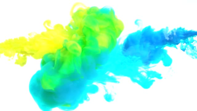 Yellow and blue ink in water.