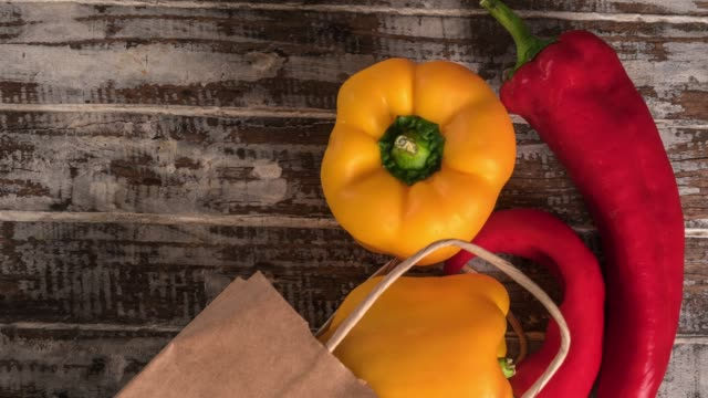 yellow bell pepper on the wood background - paprica video stock e b–roll