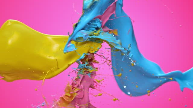 SLO MO Yellow, blue and pink color collision Slow motion locked down close up shot of yellow, pink and blue paint crashing into each other on pink background. changing form stock videos & royalty-free footage