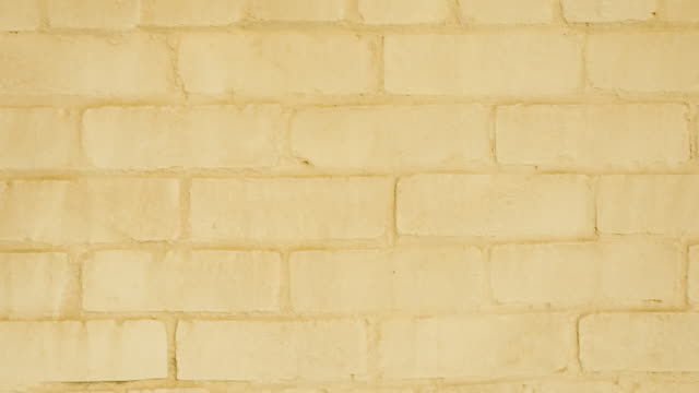 Yellow brick wall full frame panning background