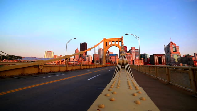 Yellow bridge to downtown - cityscape video