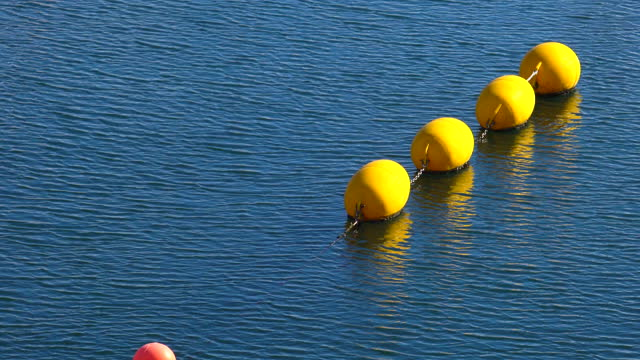 Yellow buoys on a rope in the sea