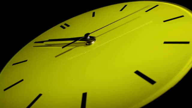Yellow clock. Time lapse. video