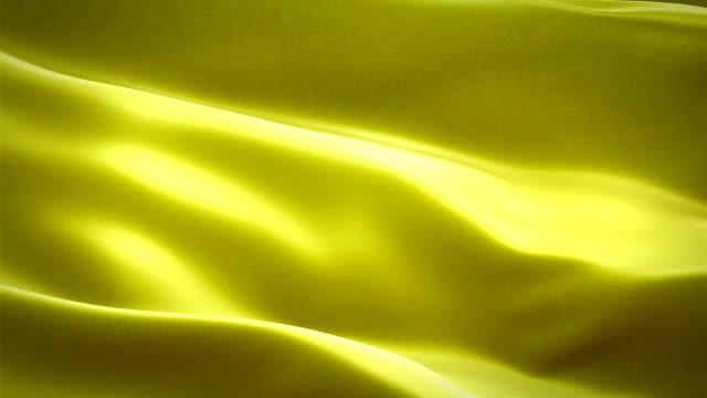 黄色の色の光沢のある生地布織物サテン背景シームレス ループ アニメーションを振って - 布点の映像素材/bロール