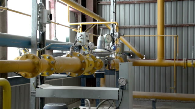 Yellow gas pipes inside Yellow gas pipes with meters inside the factory gas pipe stock videos & royalty-free footage