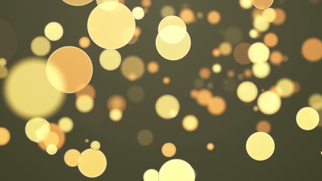 vídeos de stock, filmes e b-roll de círculos amarelos brilhantes voando bokeh fundo abstrato. loop de animação da placa de design de vídeo 4k uhd. - padrão repetido