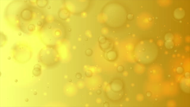 yellow golden bokeh lights particles abstract motion background - bokeh stock videos & royalty-free footage