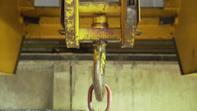 yellow heavy weight crane for a special heavy tasks in warehouse. - lega metallica video stock e b–roll