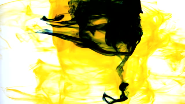 Yellow ink swirling into water whirlpool video