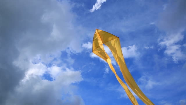 Yellow kite floating in the sky. video
